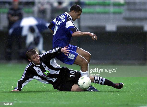 Wayne Quinn of Newcastle tackles Fabio of Troyes during the Intertoto Final First Leg between Troyes and Newcastle United at the Stade de L''Aube...