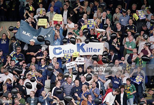 Wimbledon fans protest at the proposed move to Milton Keynes during the Nationwide League Division One match against Birmingham City played at...