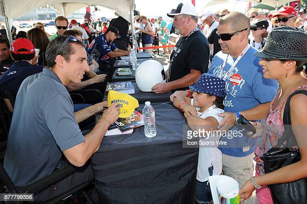 Dale Coyne Driver Justin Wilson talks with some fans during a driver autograph signing session before the MAVTV 500 Verizon IndyCar Series Race at...
