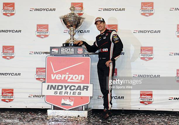 Verizon Team Penske driver Will Power with the Astor Cup after winning the 2014 Indy Car Championship after the MAVTV 500 raced at the Auto Club...