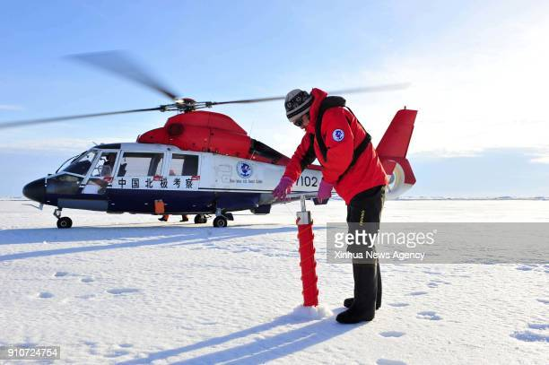 XUE LONG ICEBREAKER Aug 21 2010 He Jianfeng a member of the fourth Chinese scientific expedition team collects the ice core sample at the North Pole...