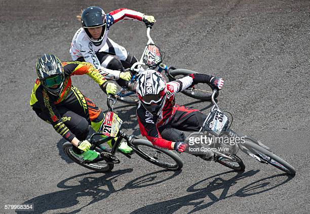 Chase's Dani George , Ssquared's Lauren Reynolds , and Staats' Kelsey Van Ogle tear through the first turn during USA BMX's Mile High Nationals at...