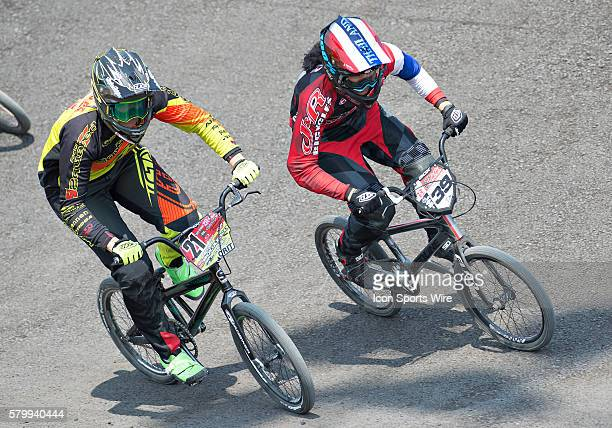 Ssquared's Lauren Reynolds and J&R Bicycles' Amanda Carr whip through turn one in the Elite Women's event during USA BMX's Mile High Nationals at...