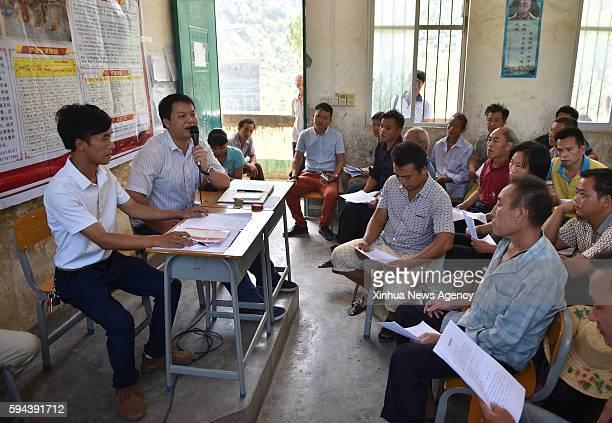 DAHUA Aug 23 2016 Lan Zhiping first left attends a villagers meeting in Nongxiong Village Dahua Yao Autonomous County south China's Guangxi Zhuang...