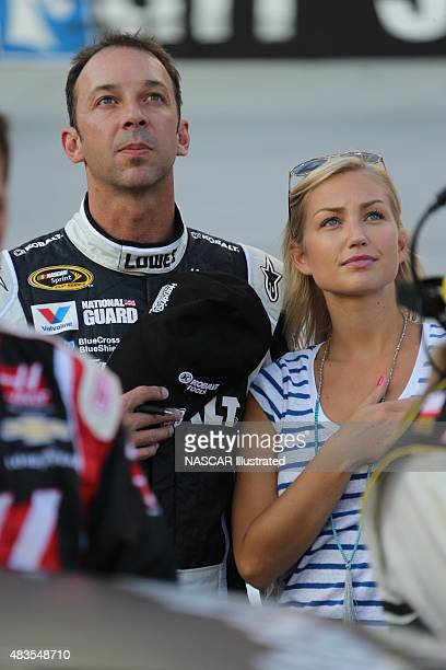 NASCAR Sprint Cup Series crew chief Chad Knaus and his girlfriend Brooke Werner stand on pit road during the National Anthem prior to the start of...