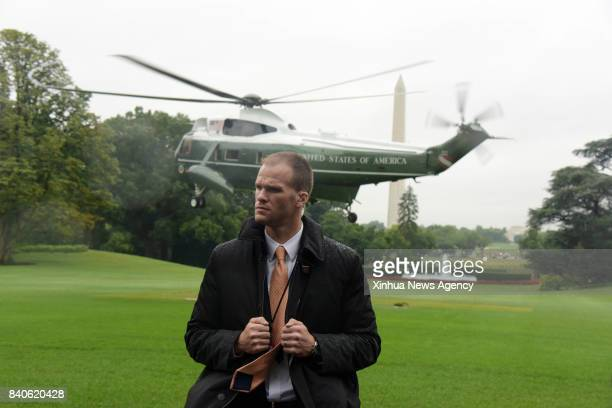 C Aug 29 2017 A secret service agent guards as the Marine One takes off with US President Donald Trump and First Lady Melania Trump on board...