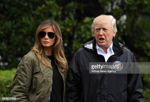 C Aug 29 2017 US President Donald Trump and First Lady Melania Trump walk to board Marine One before departing the White House for Joint Base Andrews...