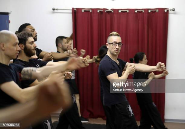 Alex Richter gives lessons to his highlevel students at his Kung Fu school 'City Wing Tsun' in New York the United States July 12 2017 Hidden in the...