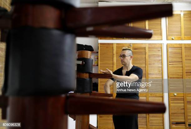 Alex Richter practices with the Wooden Dummy at his Kung Fu school 'City Wing Tsun' in New York the United States July 12 2017 Hidden in the midtown...