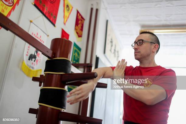 Alex Richter practices with the Wooden Dummy at his Kung Fu school 'City Wing Tsun' in New York the United States July 17 2017 Hidden in the midtown...