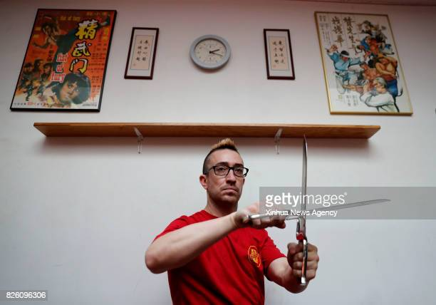 Alex Richter shows the Butterfly Swords Form in Wing Tsun at his Kung Fu school 'City Wing Tsun' in New York the United States July 17 2017 Hidden in...