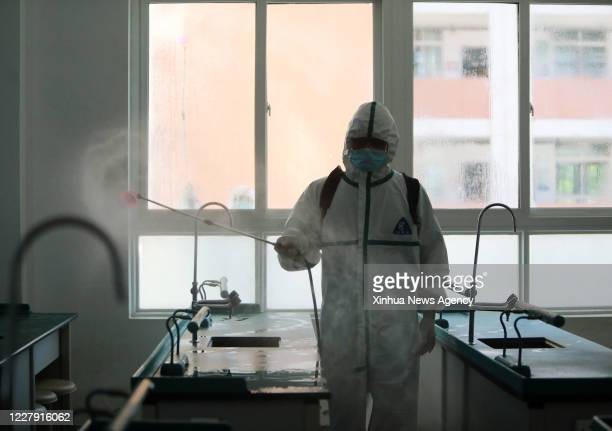 Aug. 3, 2020 -- A fireman disinfects a lab of Wuhan No. 3 Boarding School in Hanyang District of Wuhan City, central China's Hubei Province, Aug. 3,...
