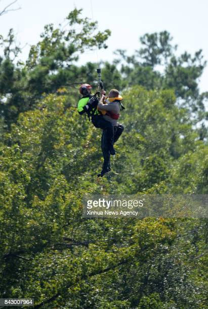 Aug 31 2017 A man trapped in flooding is rescued by helicopter in Beaumont Texas the United States Aug 31 2017 Nearly 40 people died or are feared...