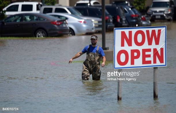 Aug 31 2017 A man walks in a flooded parking lot in Port Arthur Texas the United States Aug 31 2017 Nearly 40 people died or are feared dead in...