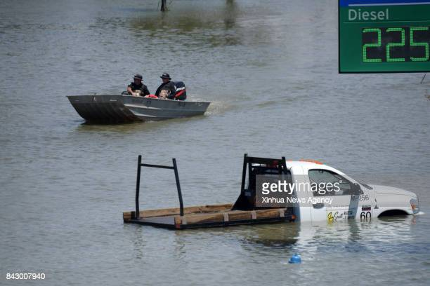 Aug 31 2017 Rescuers pass by a flooded vehicle in Port Arthur Texas the United States Aug 31 2017 Nearly 40 people died or are feared dead in...
