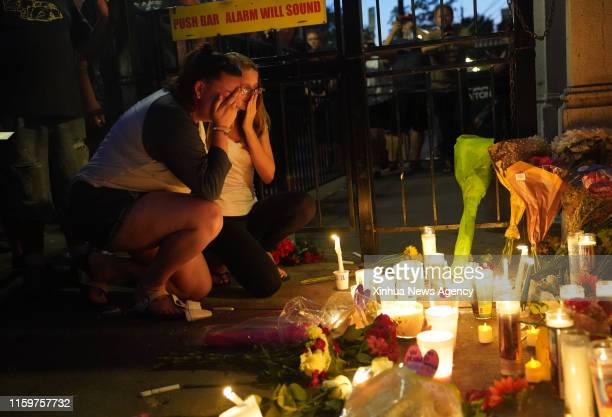 DAYTON Aug 5 2019 People attend a vigil held to mourn for victims in front of the bar where shooting occurred in Dayton of Ohio the United States on...