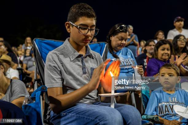 Aug. 5, 2019 -- People take part in a prayer and vigil at Ponder Park in El Paso, Texas, the United States, Aug. 4, 2019. Twenty people were killed...