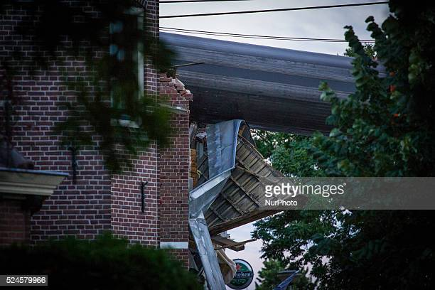 Aug. 6, 2015 - Two large cranes carrying a part of a bridge weighing 190 tons slid of a pontoon and crashed into several houses along the canal. The...