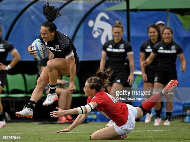 Aug. 8, 2016 -- Portia Woodman of New Zealand, left, competes during the semifinal of women's rugby sevens in Rio de Janeiro, Brazil, Aug. 8, 2016....
