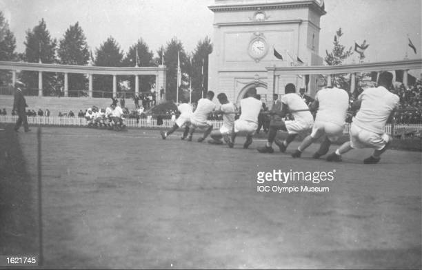 Two teams competing in the Tug of War event during the 1920 Olympic Games in Antwerp Belgium Mandatory Credit IOC Olympic Museum /Allsport