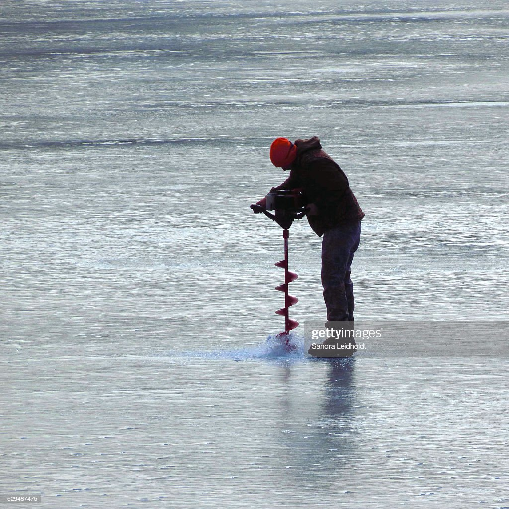 Auger Drilling For Ice Fishing Stock Photo - Getty Images