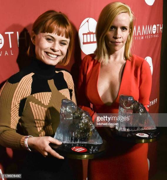 Augie Duke and Bethany Brooke Anderson pose for portrait with awards won by their film Burning Kentucky at the 2nd Annual Mammoth Film Festival on...