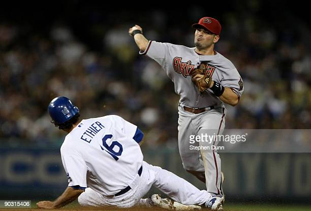 Augie Ojeda of the Arizona Diamondbacks throws to first base after forcing out Andre Ethier of the Los Angeles Dodgers on a double play in the fourth...