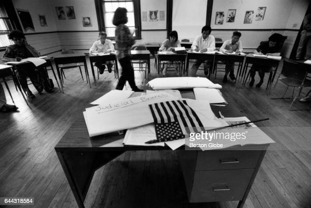 Augie Suribory teaches immigrants how to study for the citizenship exam on US history at the Asian American Civic Association in Boston on June 30...