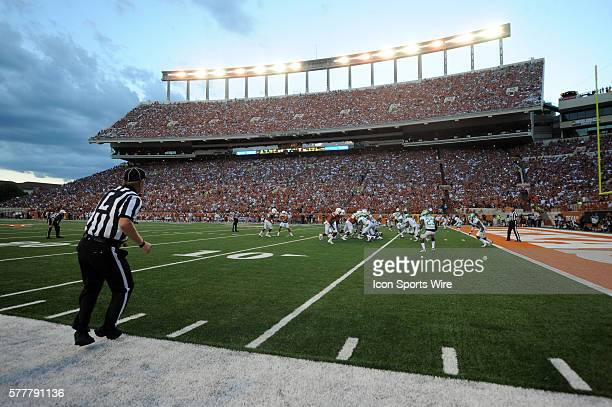 Sideline view as the sun sets during the Longhorns 38 7 win over North Texas at Darrell K RoyalTexas Memorial Stadium in Austin Texas
