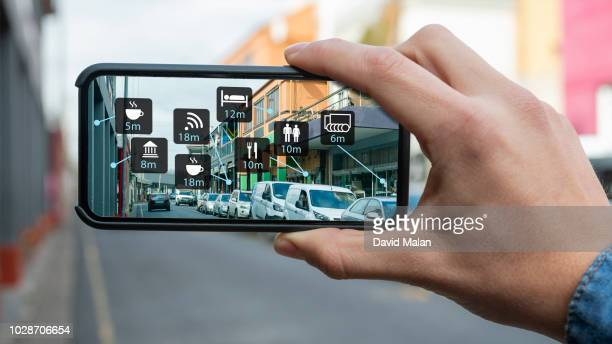 Augmented reality of a city street shown on a mobile device.