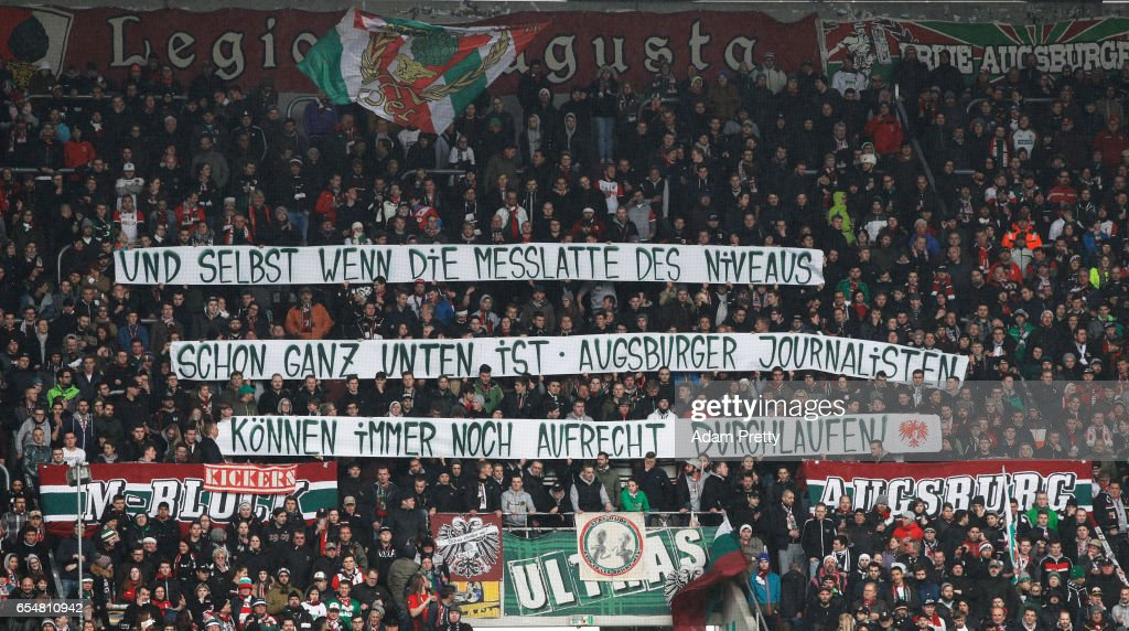 FC Augsburg fans hold up a banner during the Bundesliga match between FC Augsburg and SC Freiburg at WWK Arena on March 18, 2017 in Augsburg, Germany.
