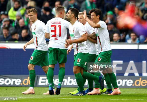 Augsburg players celebrate after their team's opening goal during the Bundesliga match between Hannover 96 and FC Augsburg at HDIArena on October 27...