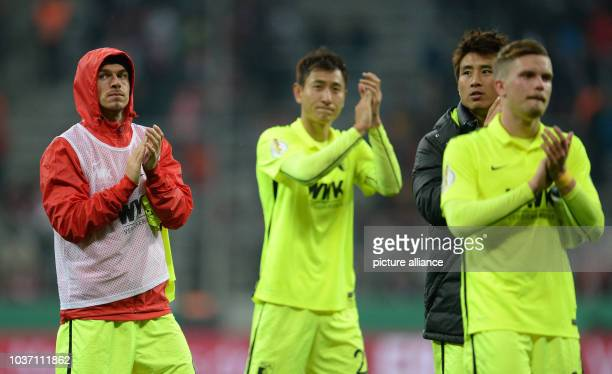 FC Augsburg players Markus Feulner JaCheol Koo DongWon Ji and Daniel Baier thank their fans in the stands after the second round DFBPokal game...