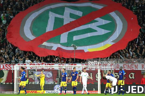 Augsburg supporters shows a banner aginst the DFB during the DFB Cup match between FC Augsburg and RB Leipzig at WWKArena on April 02 2019 in...