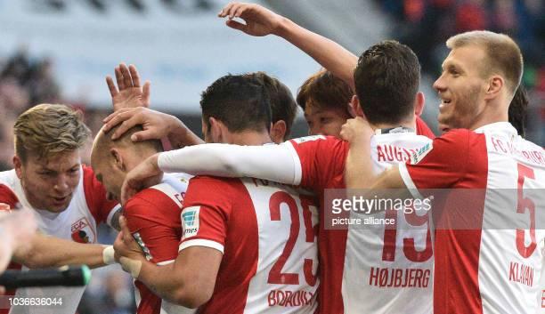 Augsburg's Alexander Esswein goal scorer Tobias Werner Raul Bobadilla PierreEmile Hoejbjerg and Ragnar Klavan celebrate their 10 lead during the...