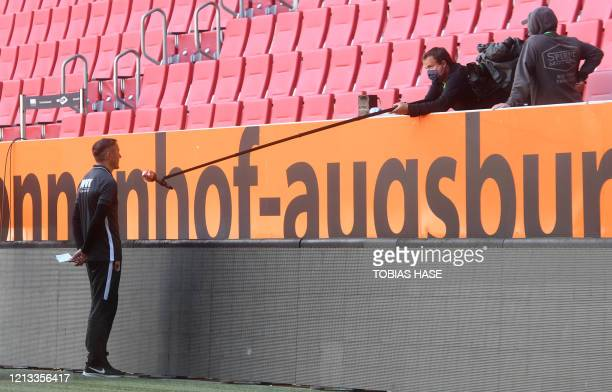 Augsburg's assistant coach Tobias Zellner gives an interview after the German first division Bundesliga football match FC Augsburg v VfL Wolfsburg on...