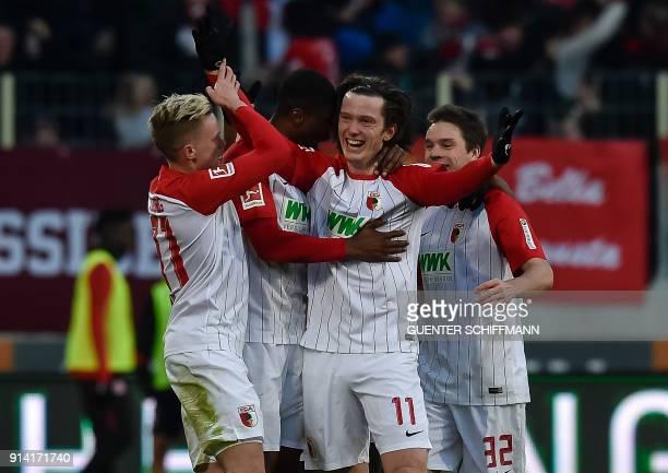 Augsburg's Austrian forward Michael Gregoritsch celebrates his goal during the German first division Bundesliga football match 1 FC Augsburg vs...