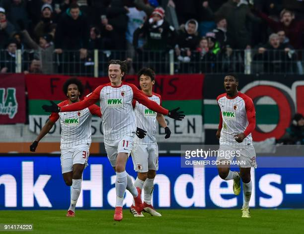 Augsburg's Austrian forward Michael Gregoritsch celebrates his goal during the German first division Bundesliga football match 1 FC Augsburg vs...