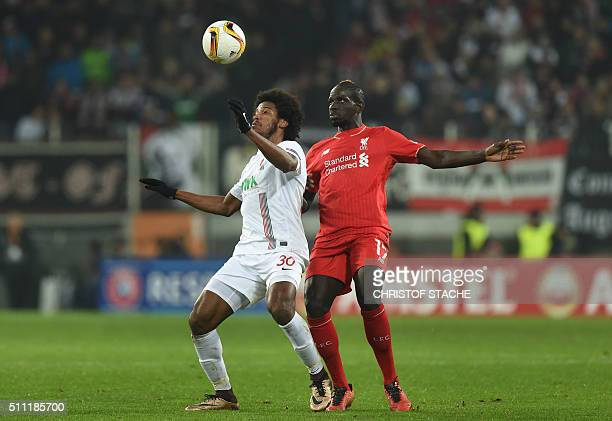Augsburg's Brazil midfielder Caiuby and Liverpool's French defender Mamadou Sakho vie for the ball during the UEFA Europa League Round of 32 football...