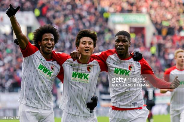 Augsburg's Brazilian midfielder Caiuby Augsburg's Korean midfielder Koo JaCheol and Augsburg's Austrian defender Kevin Danso celebrate the first goal...