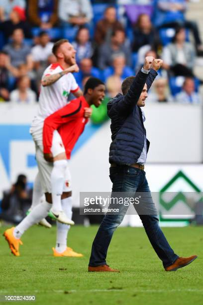 Augsburg's coach Manuel Baum celebrates staying in the First Bundesliga after the German Bundesliga soccer match between 1899 Hoffenheim and...