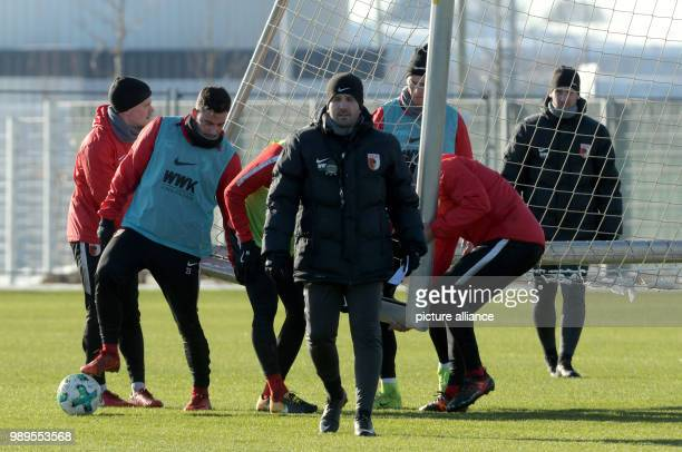 Augsburg's coach Manuel Baum stands on the pitch during the first training session for the second half of the season of the German Bundesliga soccer...