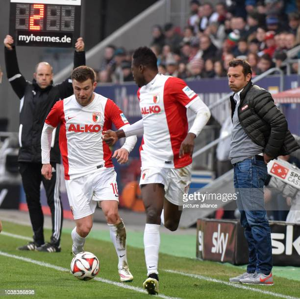 Augsburg's coach Markus Weinzierl viewss his players Daniel Baier and Abdul Baba during the German Bundesliga soccer match between FC Augsburg and...