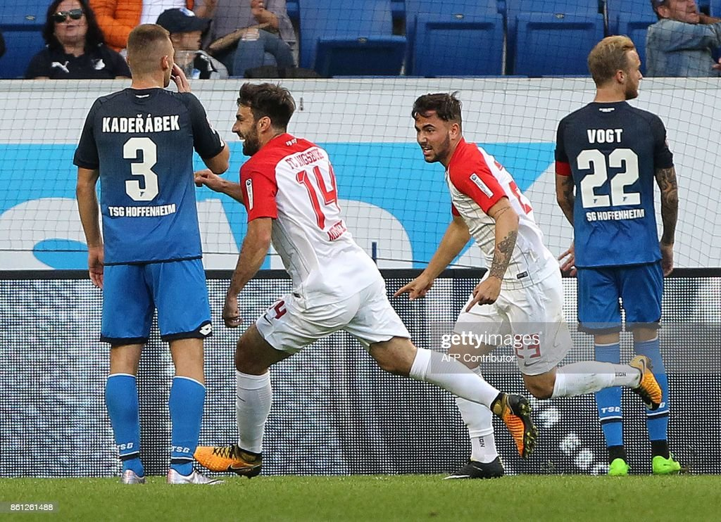 Augsburg's Czech midfielder Jan Moravek (2nd L) and Augsburg's German midfielder Marco Richter (2nd R) celebrate after Hoffenheim's German midfielder Kevin Vogt (R) scored the 2-2 with an own goal during the German First division Bundesliga football match TSG 1899 Hoffenheim vs FC Augsburg in Sinsheim, southwestern Germany, on October 14, 2017. / AFP PHOTO / Amelie
