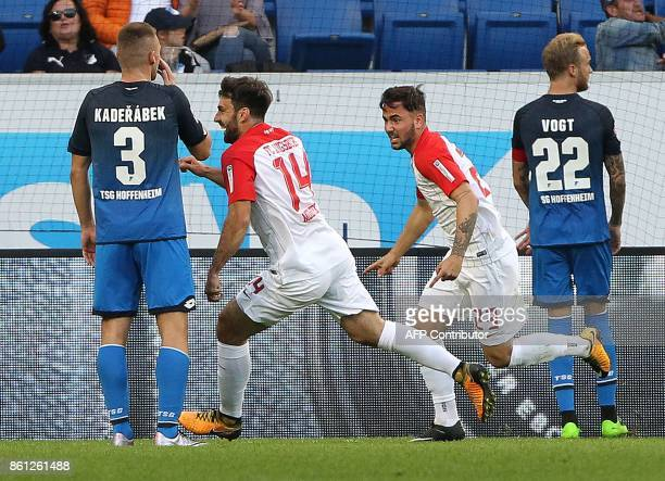 Augsburg's Czech midfielder Jan Moravek and Augsburg's German midfielder Marco Richter celebrate after Hoffenheim's German midfielder Kevin Vogt...