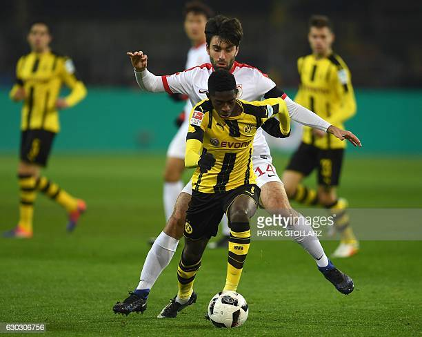 Augsburg's Czech midfielder Jan Moravek and Dortmund's French midfielder Ousmane Dembele vie for the ball during the German First division Bundesliga...