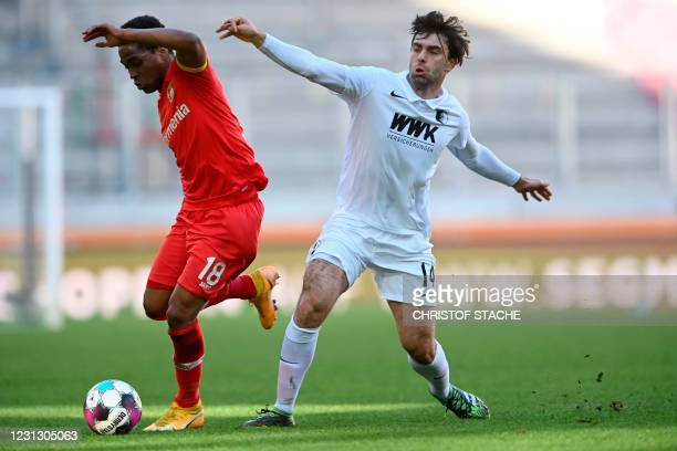 Augsburg's Czech midfielder Jan Moravek and Leverkusen's Brazilian defender Wendell vie for the ball during the German first division Bundesliga...