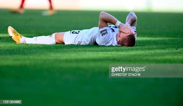Augsburg's Danish defender Mads Petersen lays on the pitch after the German first division Bundesliga football match FC Augsburg vs Bayer Leverkusen...