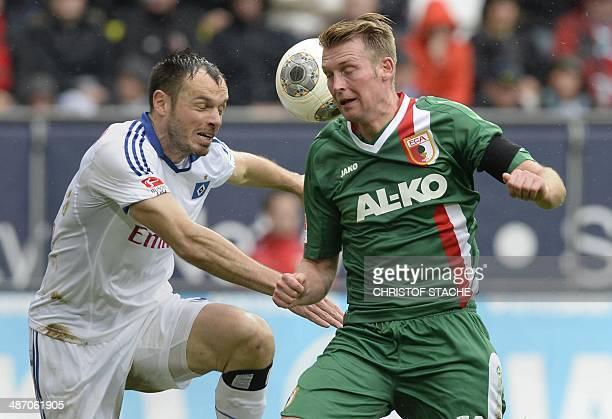 Augsburg's defender JanIngwer CallsenBracker and Hamburg's defender Heiko Westermann vie for the ball during the German first division Bundesliga...