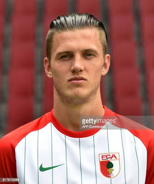 Augsburg's Dutch defender Jeffrey Gouweleeuw poses during a team presentation of the German first division Bundesliga football team FC Augsburg in...